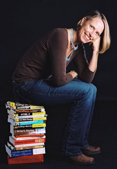 Linda sitting on books